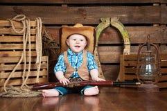 一个小男孩的画象牛仔装饰的 免版税库存照片