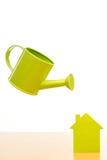 一个小的房子的概念性图片 库存图片