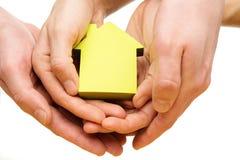 一个小的房子的概念性图片 免版税库存照片