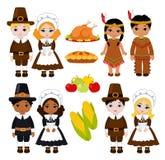 一个小组孩子-印地安人和香客-分享感恩的食物 免版税库存照片