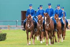 一个小组从进入竞技场的登上的卫兵的车手 免版税库存图片
