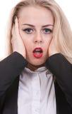 一个少妇的害怕面孔,鬼脸 免版税库存照片