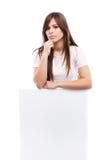 一个少妇的纵向有空白广告牌的 图库摄影