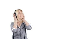 一个少妇的画象耳机的 图库摄影