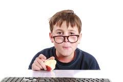 一个少年的画象有键盘的 库存照片