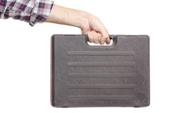 一个工具的手提箱在男性手上 免版税图库摄影