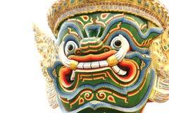 一个巨人的特写镜头头在鲜绿色菩萨寺庙的在Thailan 库存图片