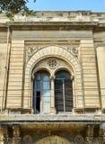一个巴洛克式的宫殿的窗口在莱切,普利亚 库存图片