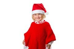 一个帽子的圣诞老人小女孩在白色背景 免版税库存照片