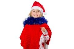 一个帽子的圣诞老人小女孩在白色背景 库存照片
