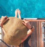 一个帽子的女孩在游艇 库存图片
