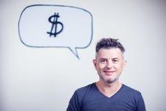 一个年轻人的画象有讲话泡影美元的符号的 库存照片
