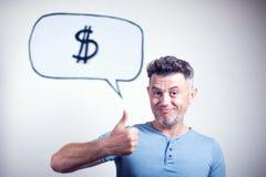 一个年轻人的画象有讲话泡影美元的符号的 免版税图库摄影