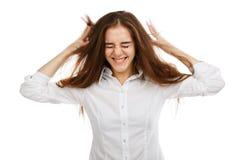 一个年轻愉快的女孩的画象白色背景的,在一件白色女衬衫 库存图片