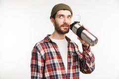 一个年轻有胡子的人游人的画象格子花呢上衣的 免版税库存照片