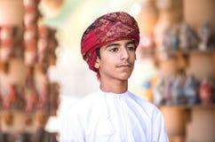 一个年轻阿曼男孩的画象 免版税库存照片