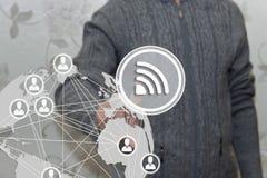 一个年长领抚恤金者选择在触摸屏上的WI-FI在迷离未来派背景 企业网络RSS 免版税库存图片