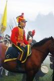 一个微笑的人的画象红色军用历史制服的 库存照片