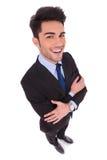 一个微笑的商人的广角图片用横渡的手 库存照片