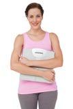 一个微笑的少妇的画象有重量标度的 图库摄影