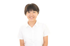 一个微笑的青少年的女孩 库存照片