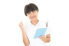 一个微笑的青少年的女孩 图库摄影
