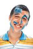 一个微笑的年轻英俊的人的画象有油漆的在他的面孔 免版税库存照片