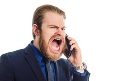 一个快乐的商人的画象谈话在白色背景隔绝的电话 免版税库存图片