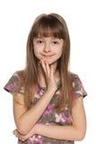 快乐的害羞的女孩 免版税库存照片
