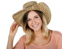 一个快乐的少年女孩佩带的草帽的演播室画象 库存图片