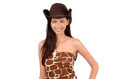 一个性感的美国女牛仔的画象有帽子的。 库存图片
