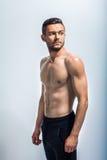 一个性感的肌肉赤裸上身的人的画象 库存照片