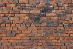 一个恶化的老砖墙能是用途每背景或  免版税库存图片