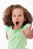 说一个恼怒的女孩的画象中止用她的手 库存图片