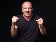 一个恼怒的秃头人的画象 免版税图库摄影