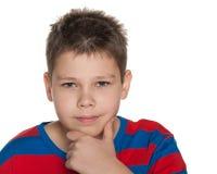 一个想法的男孩的画象 免版税库存照片