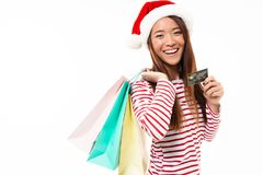 一个愉快的亚裔女孩的画象圣诞节帽子的 免版税库存图片