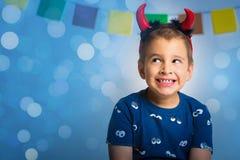 一个愉快的孩子的画象仿照万圣夜样式 免版税库存照片