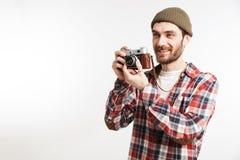 一个愉快的有胡子的人的画象拍照片的格子花呢上衣的 库存照片