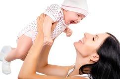 一个愉快的母亲和婴孩的画象 免版税库存照片