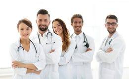 一个成功的小组的画象医生扣留 库存图片