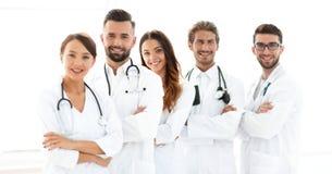 一个成功的小组的画象医生扣留 免版税库存照片