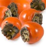 一个成熟柿子特写镜头的被隔绝的图象 免版税库存图片