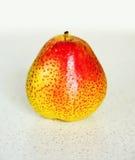 一个成熟黄色和红色梨 库存照片