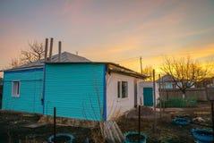 一个房子在村庄在黎明 库存照片