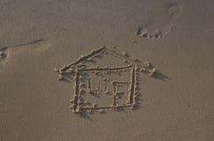 一个房子的图画海滩的 库存照片