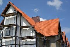 一个房子的建筑有红瓦顶的 免版税库存照片