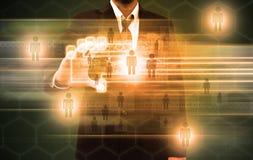 一个手指的商人扫描在触摸屏接口的 免版税库存图片