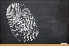 一个拇指印刷品的例证在粉笔板的 免版税库存图片