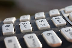 一个数字小键盘的特写镜头在直接阳光下 免版税库存图片
